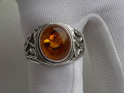 silver ring with amber stone . size AS RING STICK DETECTING FIND.