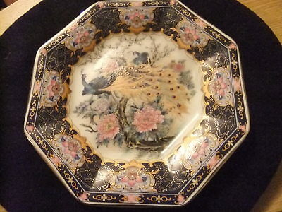 A Japanese Porcelain Octaganol Plate With Peacocks And Flowers With Gilding