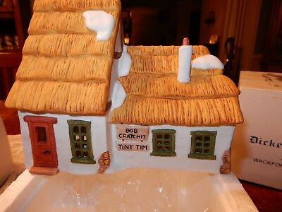 """Dept 56 Dickens' Village Series """"The Cottage of Bob Cratchit and Tiny Tim""""."""