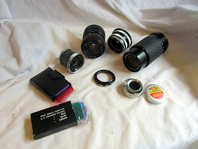 A Collection Of Vintage Lens And Filters