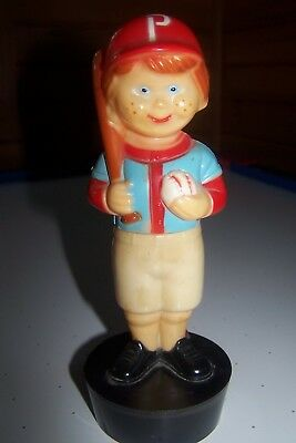 Vintage. Boy with pants that come down. Plastic. 8 in. tall. P on hat.