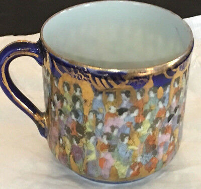 Antique Japanese demitasse cup of many figures