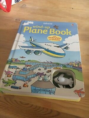 Wind-up PLANE BOOK large and thick pages with little plane and tracks by Usborne