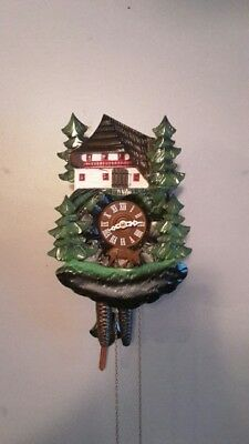 Highly detailed carved chalet Black forest cuckoo clock