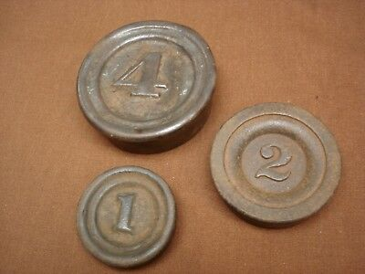 Group of 3 Antique  / Vintage nesting cast-iron mercantile balance scale weights