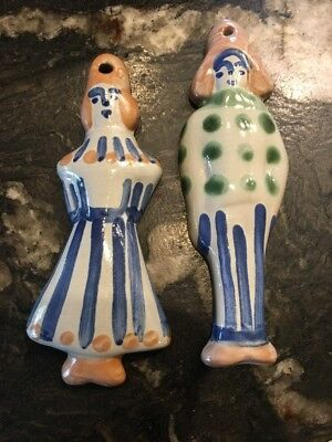 M.A. Hadley man & wife pottery ornaments
