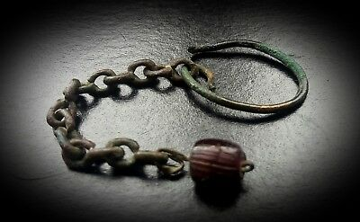ANCIENT ROMAN BRONZE DROPLET EARRING SET WITH AMBER GLASS EYE BEAD 1st - 3rd AD.