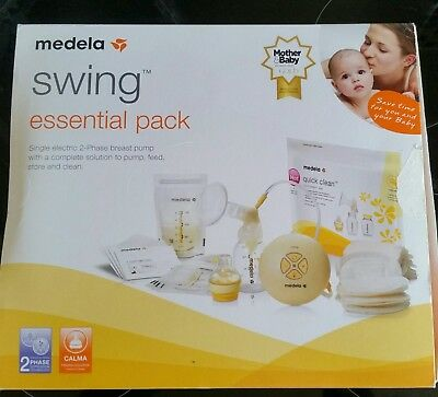 Full Medela electric swing essentials pack + calma,  used a couple of times