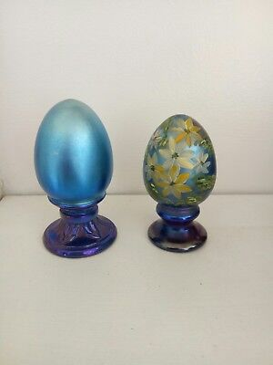 Pair of Fenton carnival glass egg paperweights; one hand-painted