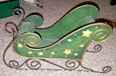 Vintage Christmas metal green and gold sleigh with stars.