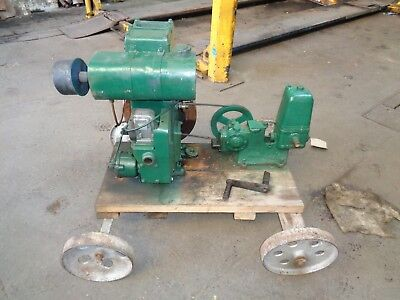lister stationary engine with lister pump and cranking handle old with cart