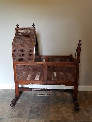 A Victorian Caned Hanging Cradle or Bassinet. England circa 1880 A Victorian...