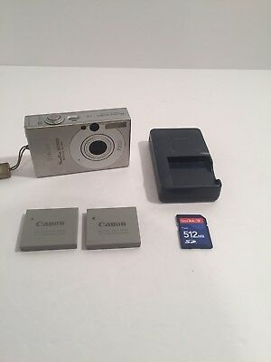 Canon PowerShot SD1000 7.1MP Digital Camera - Silver w/ Charger, Memory Card