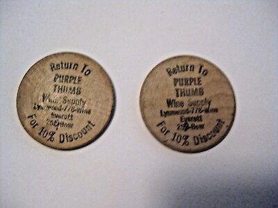 2 Vintage Purple Thumb Wine Supply Everett Advertising Wooden Nickels / Tokens