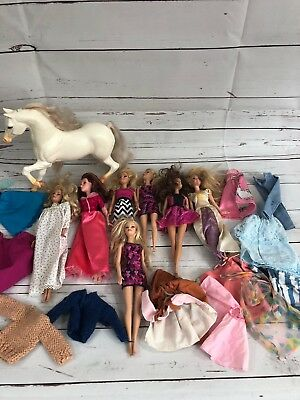 Lot Of 7 Barbies With Horse And Clothes