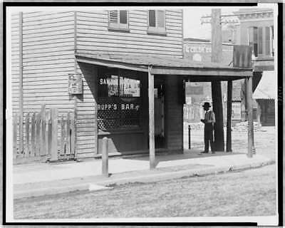 African American man,front of Rupp's Bar,St. Louis,Missouri,MO,1890-1933