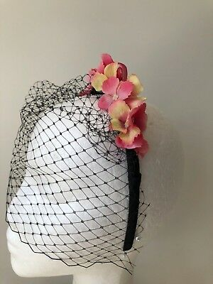 New cute pink flowered headband with black netting! One only!