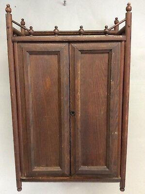 """Antique Oak Stick and Ball Wall Mounted Cupboard 16.25""""W."""