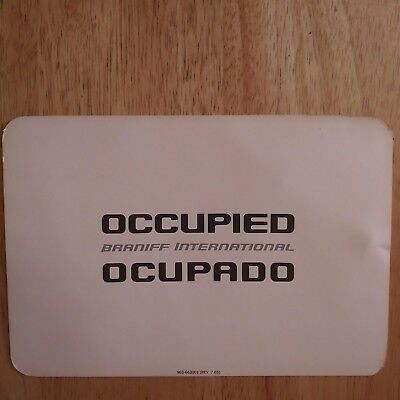Braniff sign- Occupied plane seat sign - Original Braniff