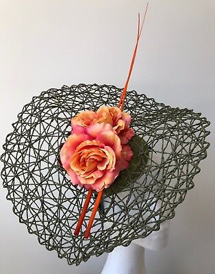 New Green basketweave fascinator with orange flowers and quills on a headband!