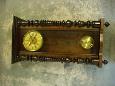 Antique wood and glass case wall clock