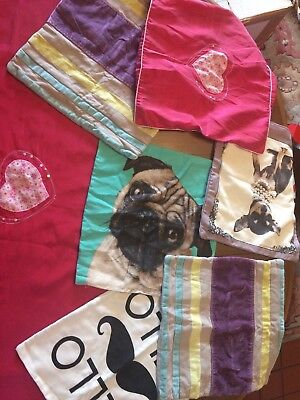Bundle Of Cushion Covers And A Bed Runner