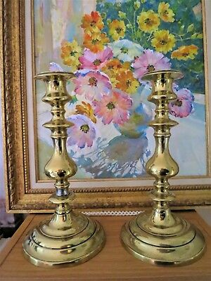 A pair of Antique Georgian Brass Candlesticks with pushers C1800