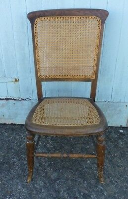 Antique bedroom or kitchen chair, cane woven seat and back