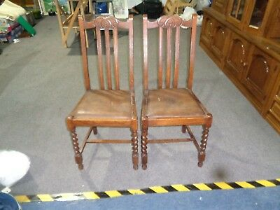 a pair of antique dining chairs for restoration