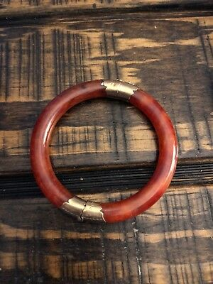 red jade bangle bracelet with gold clasps