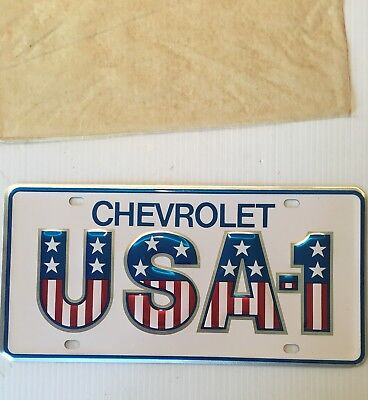 USA-1 SMALL HOLE LICENSE PLATE CHEVROLET VINTAGE ORIGINAL GM DEALER PLATE Mint