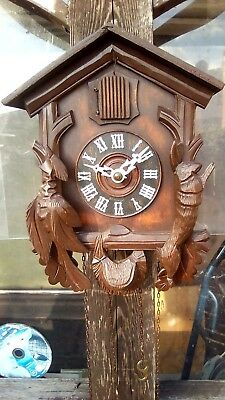 Vintage old black forest cuckoo clock