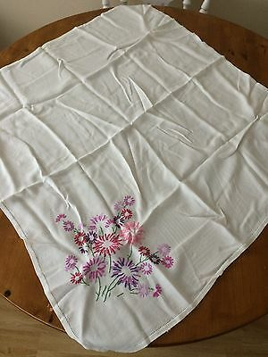Vintage hand embroidered tablecloth with floral design in one corner