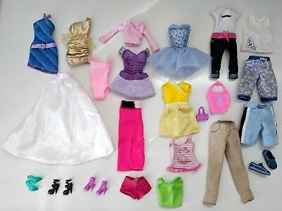 Huge lot of Barbie and Ken doll dresses shorts shirts clothes shoes lot