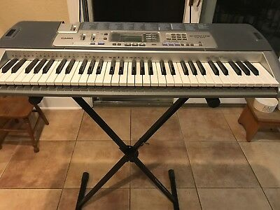 Casio LK-110 Keyboard with Key Lighting System and Stand - Great Condition