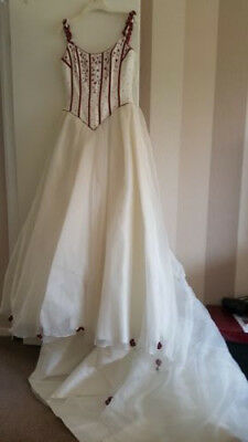 Beautiful wedding dress with matching gloves and veil by sincerity bridal