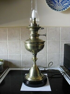 tall old heavy brass oil lamp  converted to electric with  ceramic base(now £50)