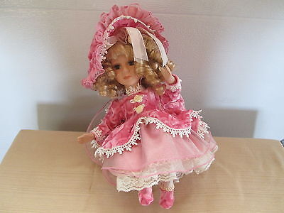 """Adorable 11"""" Porcelain Doll - Play music and move"""