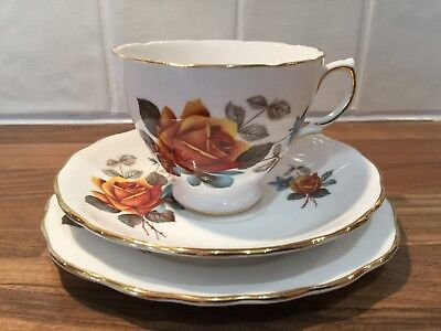 Vintage Royal Vale English bone china tea cup trio set orange floral design