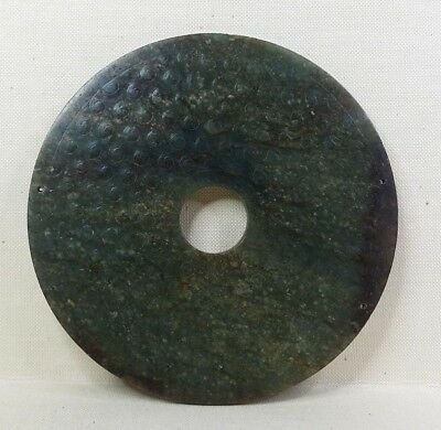 """Antique Chinese archaic disc made from """"Spinach"""" jade."""