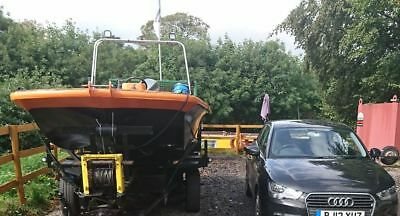 Steel wrapped commercially licensed Rigid Raider on portable slipway trailer.