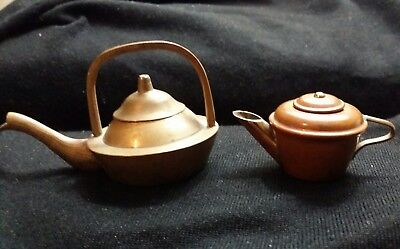 Two vintage miniature toy teapots, one copper, one bronze or brass