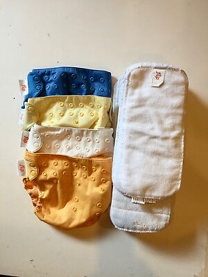 Four Used Flip Cloth Diaper Covers and 14 inserts