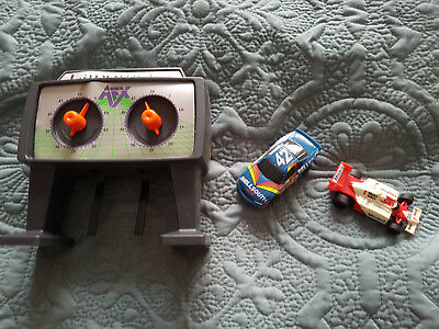 Two Tomy AFX slot cars and lapometer