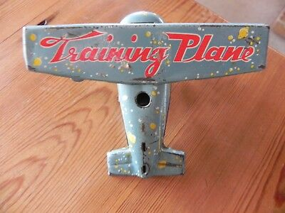 Tin Toy Training Plane. Wind Up, Made in China.
