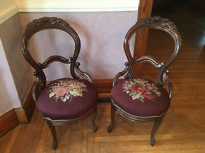 set of two wood rose carved antique dining chairs with embroidered seats