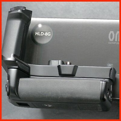 Olympus  HLD-8G camera grip and battery holder.