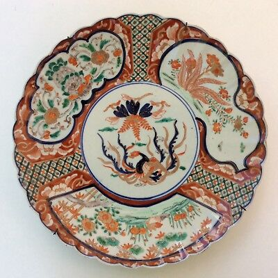 A late 19th century Japanese Imari charger or plate. Early Meiji period.