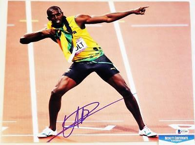 USAIN BOLT SIGNED AUTOGRAPHED 11x14 PHOTO OLYMPIC GOLD MEDALIST BECKETT BAS 389