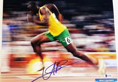 USAIN BOLT SIGNED AUTOGRAPHED 11x14 PHOTO OLYMPIC GOLD MEDALIST BECKETT BAS 390